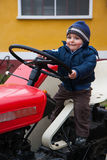 Baby on tractor old Stock Photo