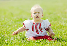 Baby in traditional folk clothes Royalty Free Stock Image