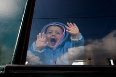 Baby in train window royalty free stock image