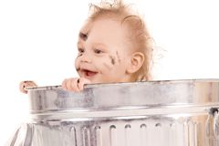 Baby in trash can Stock Image
