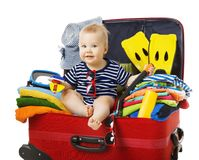 Baby Travel Suitcase, Child Sit in Traveling Baggage, Kid on White. Baby Travel Suitcase, Child Sit in Traveling Baggage, Kid into Vacation Luggage Full of Beach Royalty Free Stock Photos