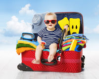 Baby in Travel Suitcase. Kid inside Luggage Packed for Vacation. Full of Clothes, Child and Family Trip Royalty Free Stock Photo