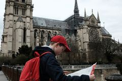 Baby travels. Cathedral of Notre Dame de Paris France 03.20.2019 stock photos