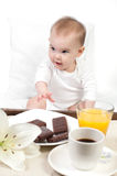 Baby and a tray with breakfast Stock Photo