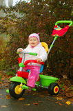 Baby on a tricycle Royalty Free Stock Image