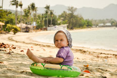Baby on tropical beach. Baby girl on tropical beach in Thailand. Picture taken in March 2014 on Koh Pha Ngan island, Thailand royalty free stock image