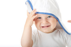 Baby trying on basebal cap Stock Photography