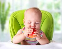 Baby trying first food.Child with apple. stock images