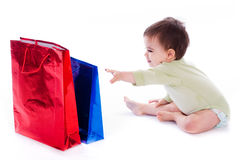 Baby Trying To Pull The Shopping Bag Royalty Free Stock Photo