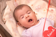 Baby trying to sleep. Emotional yawning of the child before bedtime Royalty Free Stock Images