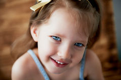 Baby with a tuft on the head, with blue eyes and playful smile Stock Photography