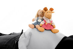 Baby tummy with stuffed animals Stock Images