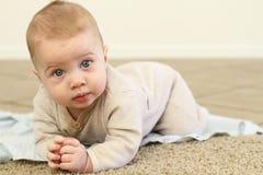Baby Tummy Time. A beautiful blue eyed baby boy Stock Image