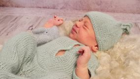 Baby turning, yawning, moving his hands stock footage