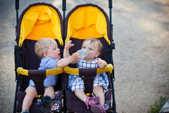 Baby twins. Boy and girl in pram Stock Photo