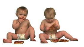Baby twins eating sandwiches stock footage