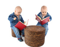 Baby twins reading book Royalty Free Stock Photo