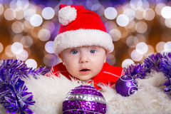 Baby twins in santa costumes for Christmas Royalty Free Stock Photography