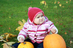 Baby with two pumpkins Royalty Free Stock Photo