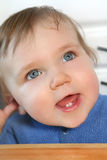 Baby with two teeth. Adorable baby smiling and showing two new teeth Royalty Free Stock Photo