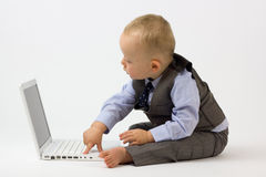 Baby Typing on Laptop Stock Image