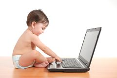 Baby typing on a laptop computer keyboard Royalty Free Stock Image