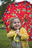 Baby with  umbrella. Child play with red umbrella Stock Photo