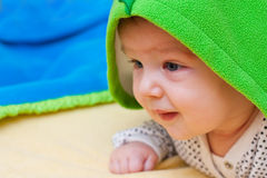 Baby under a blanket stock photos