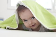 Baby under blanket Royalty Free Stock Photos