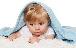 Baby under blue blanket. Royalty Free Stock Images