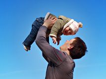 Baby under blue sky. Father with baby under blue sky Stock Photos