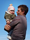 Baby under blue sky. Father with baby under blue sky Stock Photo