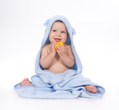 Baby under blue towel on white Royalty Free Stock Image