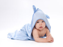 Baby under blue towel on white Stock Images