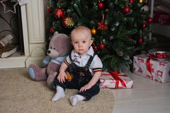 Baby under the Christmas tree Royalty Free Stock Photo