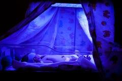 Baby under Phototherapy. Newborn baby with neonatal jaundice and high bilirubin hyperbilirubinemia under blue UV light for phototheraphy stock image