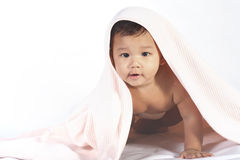 Baby Under A Quilt royalty free stock photos