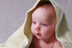 Baby under towel Stock Photo