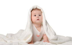 The baby under a towel Royalty Free Stock Photos