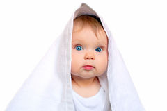 Baby under the white towe Royalty Free Stock Images