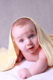 Baby under yellow blanket Royalty Free Stock Photography