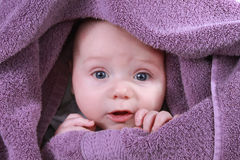Baby under yellow blanket Royalty Free Stock Images