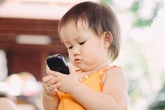 A baby using cell phone royalty free stock photos