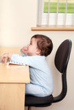 Baby using computer Stock Images