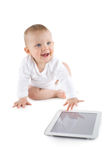 Baby using digital tablet. Baby girl on white background Royalty Free Stock Image