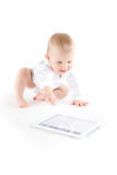Baby using digital tablet. On white Stock Photos