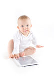 Baby using digital tablet. On white Royalty Free Stock Photography