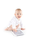 Baby using digital tablet. On white Royalty Free Stock Photos