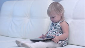 Baby using digital tablet at home stock footage