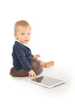 Baby using digital tablet on white Royalty Free Stock Image